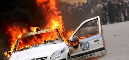 burning copcar in greece